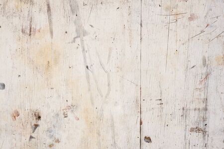 imperfect: Weathered and damaged white painted timber surface for background