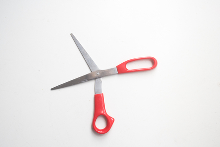 table top: High angle view of red scissors on white background