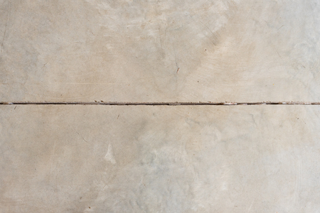 Full frame view of sealed concrete floor with expansion line from above - abstract background