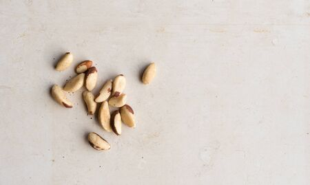 High angle view of brazil nuts on limestone background with copy space Stock Photo