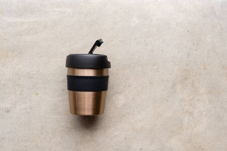 High angle view of reusable coffee cup on concrete background 版權商用圖片