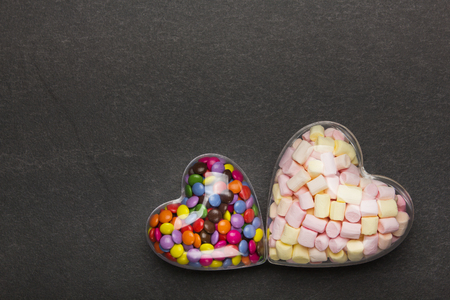 Colored candy in the shape of a heart. Background with sweets for Valentines Day.
