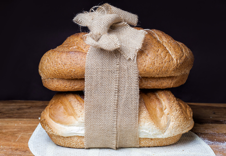 different bread on the wooden table, flour, sackcloth Stock Photo