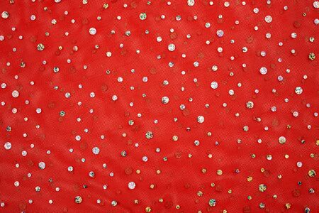 Red tulle with gold brilliant sequins Christmas, new year background