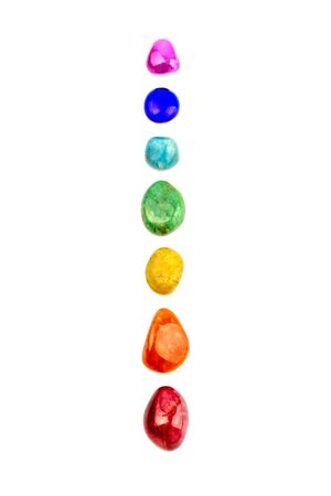 Chakra stones, crystals in a row on white background, isolated 免版税图像