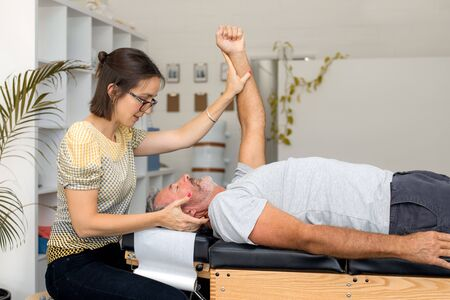 Man having chiropractic back adjustment. Physioterapy, osteopathy, alternative medicine pain relief rehabilitation Stock Photo