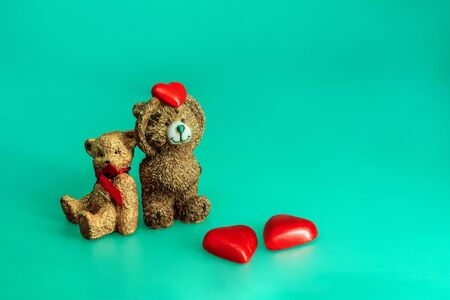 Bear toys with hearts on aqua menthe color background, love Valentines day concept 写真素材