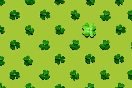 Pattern of shamrock and clover leaves on green background. St. Patrick's Day, selective focus.