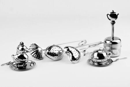 Different kinds of stainless tea strainers isolated on white background.