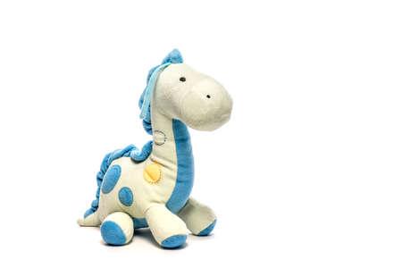 Toy dinosaur isolated on white background, soft fluffy toy