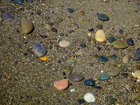 Holiday impressions - Scenic summer wet pebble beach with excellent sand and stones Stock Photo