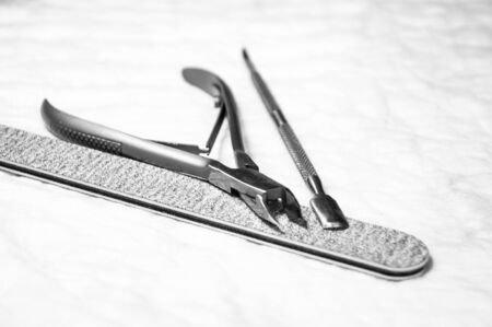 Manicure tools - photo, grayscale. Nail file, forceps. Facial care manicure room Stock fotó