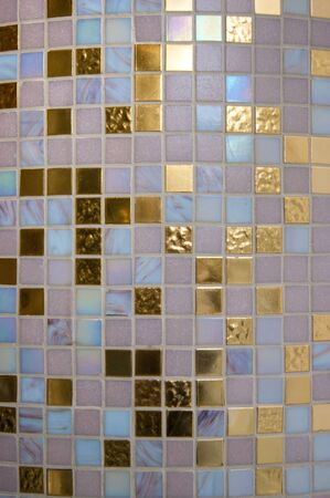 The texture is a mosaic of small square ceramic tiles. Colors are beige, blue and gold. Design, shine, luxury, expensive Stok Fotoğraf