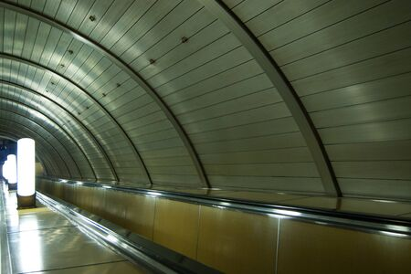 Moscow metro, escalator, rhythm of repeating design elements and lamps. Silence, peace, desolation, emptiness Reklamní fotografie
