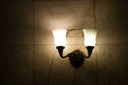 The design element is a lamp with two horns in the Moscow metro. Light, electricity, lighting, darkness Stok Fotoğraf