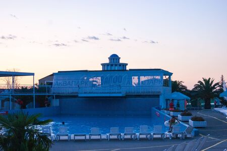Sunset in the water park Akvaloo - Russia, Loo Sochi, September 2019. View of the building and pool.