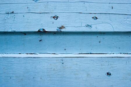 Natural background for a website or blog, texture - painted wood. Blue, cracked, cracker, stains, bitches, natural material, vintage Фото со стока