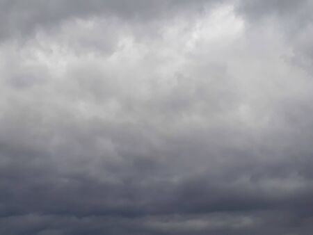 Low gray northern sky with melting clouds. Clouds, atmosphere, bad weather. Cloudy, humid. It's going to rain soon.