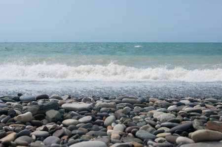 A small storm three or four points at sea, the wave hits the shore with a large pebble. Black Sea, summer vacation vacation beach travel Фото со стока