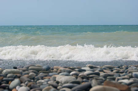 The Sea Wave of the Black Sea is a pebble beach. Smooth horizon, blue sky. Vacation vacation vacation summer happiness appeasement