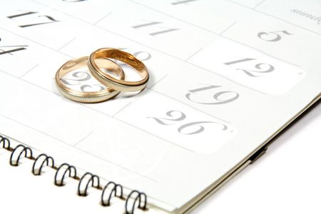 weddingrings: Couple of Weddingrings on Calender symbolizing wedding date or anniversary Stock Photo