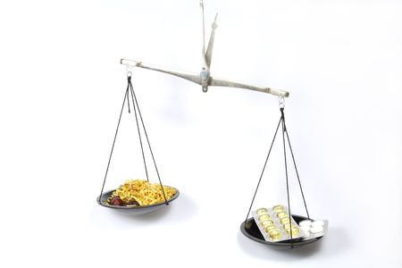 Scales symbolizing Traditional medicine is more effective than homeopathy Stock Photo - 6304810