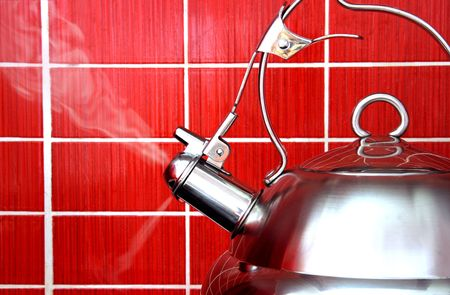 Boiling Polished Kettle on Red Tile Background Stock Photo - 6578251