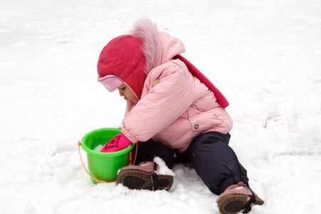 Little Baby Playing with Snow in Winter Outdoors Stock Photo - 6599766