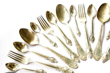 cubiertos de plata: Conjunto de Forks, de cucharas de t� y de cucharas de plata Foto de archivo