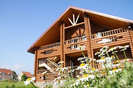 blue facades sky: Rural Wood Cottage Front Exterior against Blue Sky