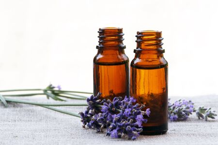 Aromatherapy Aroma Oil in Glass Bottles with Lavender Stock Photo - 7468486