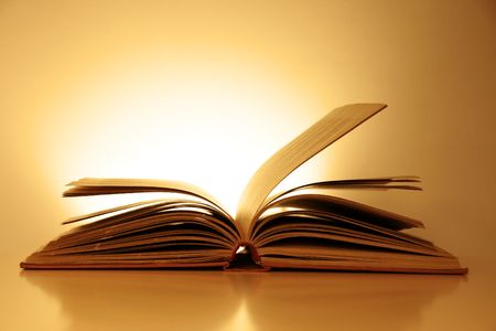 Old Fashioned Open Book Lighted Vintage Background photo