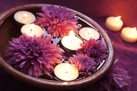 Aroma Bowl with Candles and Flowers in Violet Stock Photo