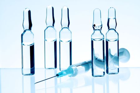 Group of Ampoules and Syringe for Injection photo