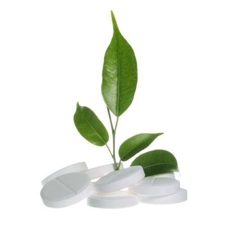 Pills with Leaf as Herbal Medicine Symbol on White photo