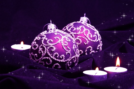 Violet Christmas Balls and Candles on Velvet