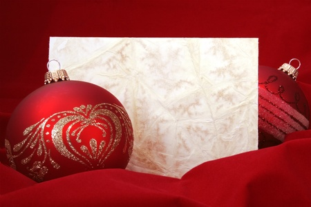 Two Red Christmas Balls with Blank Embossed Paper photo