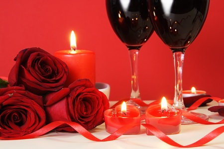 Heart Candles, Red Roses and Wine Romantic Meal Concept photo