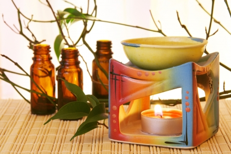 Oil Bowl Burner and Bottles Aromatherapy Concept photo