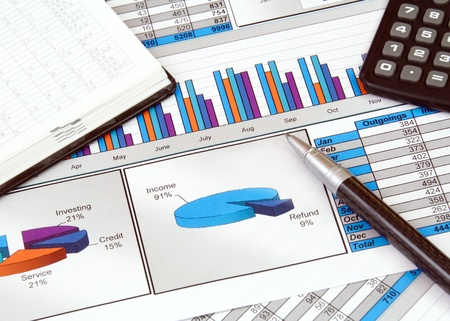 Business Still Life with Graphs Stock Photo