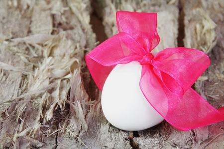 Festive Easter Egg with Purple Bow photo