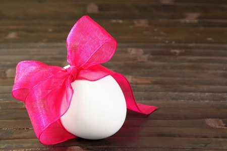 Festive Easter Egg Tied with Purple Ribbon photo