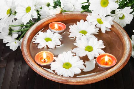aroma bowl: White Flowers Aroma Bowl with Candles Spa Stock Photo