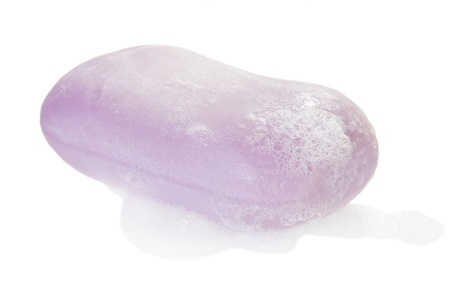 Stuk zeep en schuim geïsoleerd op wit Stockfoto