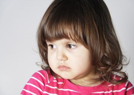 Niña con malestar expresión molesta el retrato de cara Foto de archivo - 9119698