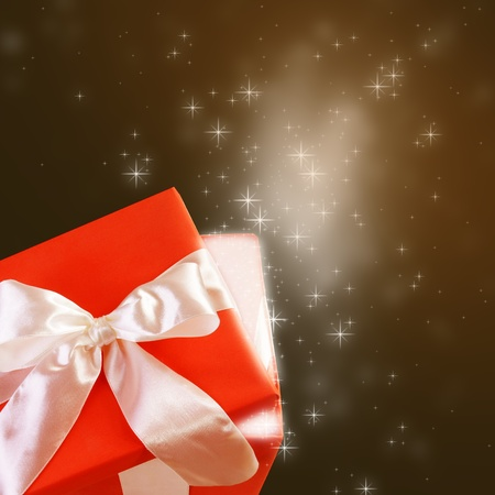 Gift Box with Magic Glowing Light and Sparkles photo