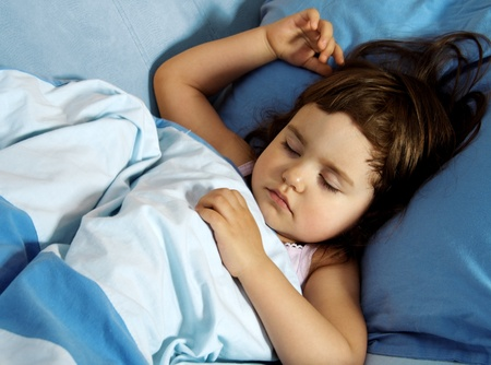 sleeping kid: Little Cute Girl Quietly Sleeping in Her Bed Stock Photo