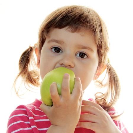 Little Curly Girl Eating Fresh Green Apple Stock Photo