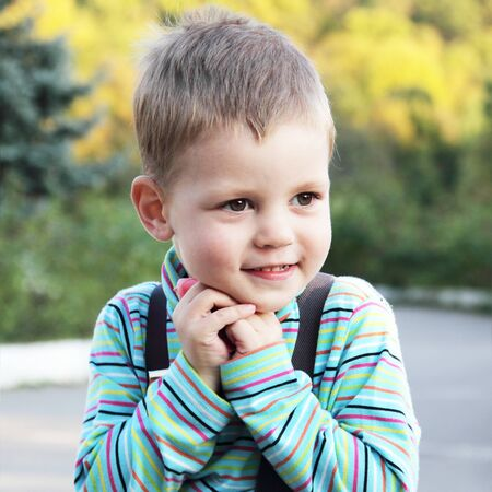 Little Cute Smiling White Boy Outdoors Portrait Stock Photo - 10858663