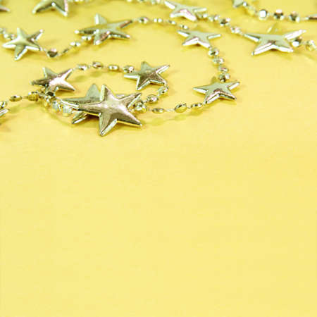 Christmas Golden Background with Silver Stars Garland photo